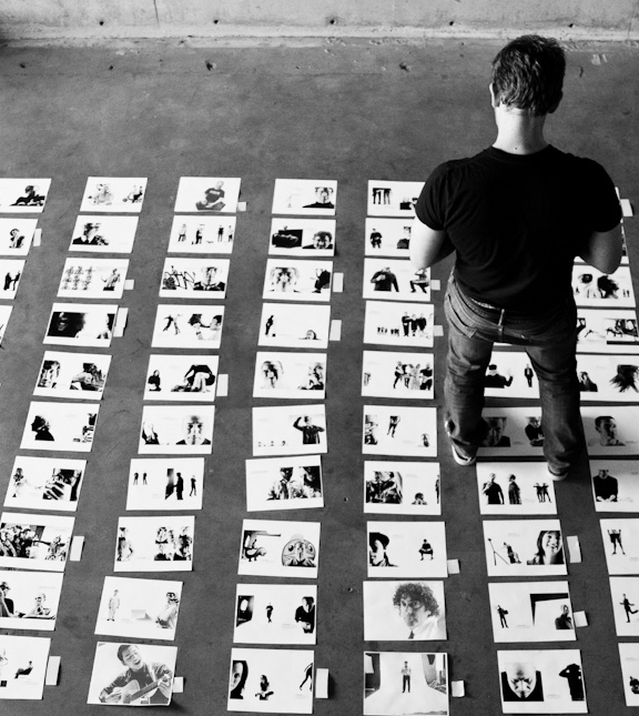 Chase laying out the image order for the Seattle 100 book.