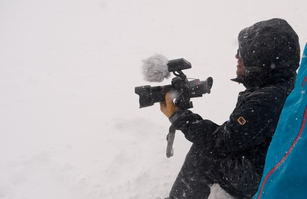 Yours truly sitting in snowstorm with Nikon D7000 video rig.