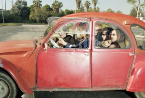 High school students facing north at 0 mph on Sepulveda Boulevard in Westwood, California, at 3:01 p.m. on a Saturday in February 1997