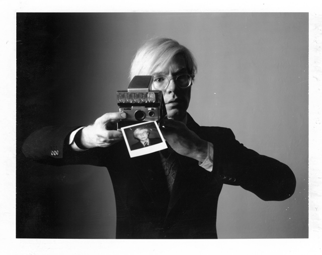Andy Warhol with Polaroid SX 70