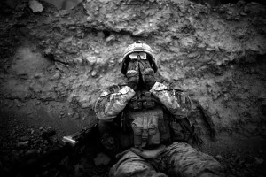 Lance Corporal Anthony Espinoza Bravo Co. 1/5 Marines, wipes the salt and sweat out of his eyes which drips down out of his helmet at the end of a day long patrol out of Patrol Base Fires in Sangin District, Helmand province, southern Afghanistan on May 4, 2011. Fighting between the Marines and insurgents was at an all time low in the past year as farmers were in the fields harvesting the poppy crop. The Marines are waiting to see if the fighting will continue as soon as the farmers are out of their fields.