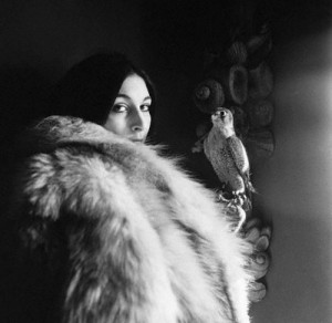 October 1968, USA --- Anjelica Huston looks into the camera wearing a fur coat and holding a falcon. Circa October 1968. --- Image by © Condé Nast