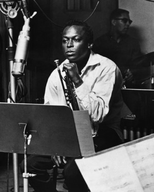 ca. 1963, USA --- The American jazz trumpeter Miles Davis (1926-1991) in the recording studios of Fontana records. --- Image by © Hulton-Deutsch Collection/CORBIS