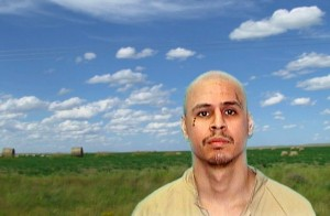 Photo by Laurie Jo Reynolds and Chris X. The prisoner requested a photo of himself in front of a blue sky.