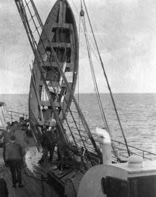 RMS Titanic lifeboat being emptied of water aboard the Carpathia