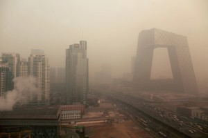 Heavy pollution surrounds the China Central Television headquarters building (right) in Beijing on January 18, 2012. The US embassy, which has its own pollution measuring system and which rates anything over 150 as unhealthy, was showing an index of 403, or 'hazardous'. (Ed Jones/AFP/Getty Images)