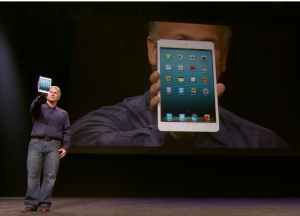 Phil Schiller holds up the iPad mini