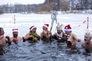 The 'Seehunde Berlin' ice swimming group goes for a Christmas Day plunge in the freezing waters of Berlin's Oranke Lake. Photo Credit to Schreiber/AP.