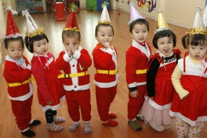 Party hats all around for these Santa Helpers in Hanoi, Vietnam. Photo Credit: Kham / Reuters.