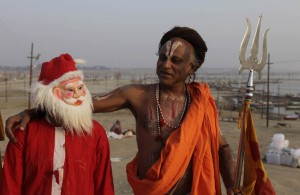 Santa and a Hindu holy man bro out in Allahabad, India. Photo Credit: Rajesh Singh / AP.