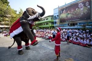 These elementary students are given a Christmas Eve show in Ayutthaya, Thailand. Photo Credit: Longstreath / AP.