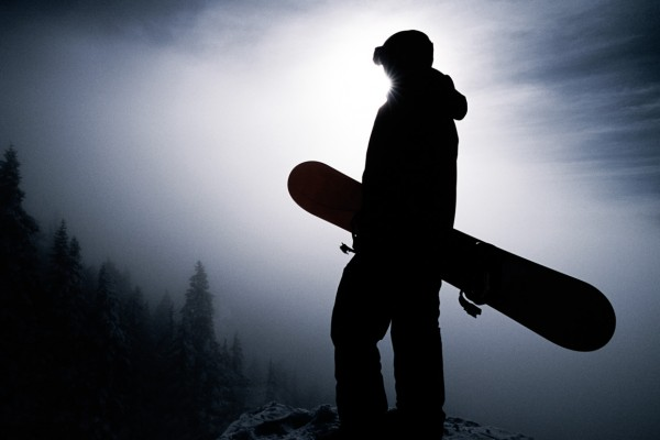 Silhouetted Snowboarder